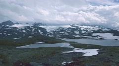 Scenic aerial view of Styggevatnet with snowy mountains on the background Stock Footage
