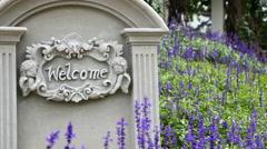 4K : Welcome sign on stone background with lavender flower, Tilt up shot Stock Footage