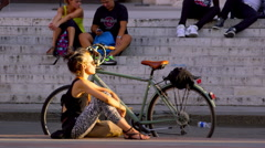 WOMAN SITTING SUN PIAZZA MAGGIORE BOLOGNA Stock Footage