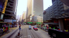 TRAMS BUSES RED TAXIS CENTRAL HONG KONG CHINA Stock Footage