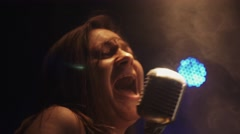 Scrubwoman sing in vintage microphone on stage of club. Dance. Smoke. Spotlight Stock Footage
