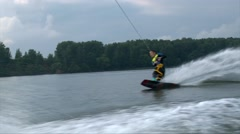 Wakeboarder man crushes in the water Stock Footage