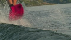 Tilt up woman wakeboarder on water splash, close up shot Stock Footage