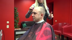 Woman hairdresser cut man client in own barbershop. 4K Stock Footage