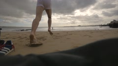 Guys running into the sea - Slowmotion Stock Footage