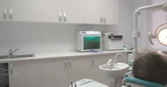 Dentist treats the patient's tooth Stock Footage