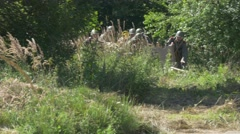 Soldiers moving a anti tank gun along a road and make it ready to fire Stock Footage