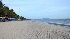 Bangsaen Beach in dusk time in Chonburi, Thailand. Stock Footage
