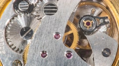 Moving metal gears inside working watch mechanism  Stock Footage