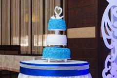 Multilevel wedding cake. Sweets in white and blue colour Stock Photos