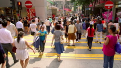 PEDESTRIANS CROSSING CAUSEWAY BAY HONG KONG CHINA Stock Footage