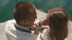 Close up of couple kissing outdoors on lakeshore Stock Footage