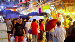 SHOPPERS UMBRELLAS MARKET WAN CHAI HONG KONG CHINA Stock Footage