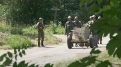 A Anti tank gun crew check their equipment Stock Footage
