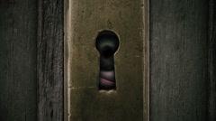 Moving eye behind keyhole. Stock Footage