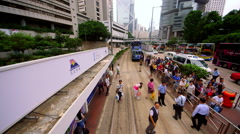 CROWDS OF PEOPLE ON TRAM LINE CENTRAL HONG KONG Stock Footage