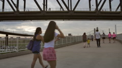 People Walk Up The Ramp to Big Four Bridge Stock Footage