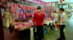 PREPAIRING MEAT AT BUTCHERS NORTH POINT HONG KONG Stock Footage