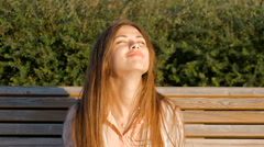 Attractive girl - happy. Good mood, summer, wind. Stock Footage
