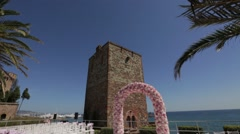 Elegant wedding arch of flowers on the coast Stock Footage