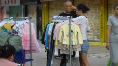 Shenzhen, China: roadside stalls, the sale of clothing and other goods Stock Footage