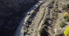 Car stopping on dirt road turnout, Santa Fe, New Mexico, United States Stock Footage