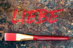 Brush and german word, color symbolism for the color red Stock Photos
