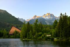 Mountain lake Strbske pleso in National Park High Tatras at sunset Stock Photos