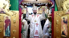 An Orthodox priest celebrates mass on Christmas Eve vigil in a church Stock Footage