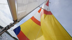 Multicolored Sail blows in wind on a boat. Stock Footage