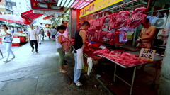 BUTCHER SERVES CUSTOMER NORTH POINT HONG KONG Stock Footage