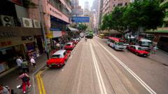 RIDING ON TRAM IN STREET WAN CHAI HONG KONG CHINA Stock Footage