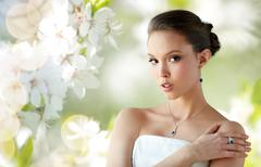 Beautiful woman with earring, ring and pendant Stock Photos