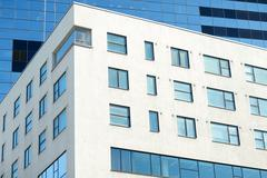 Close up of multistory office building in city Stock Photos