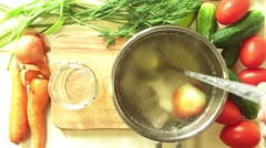 Man pours chicken broth in a glass jar Stock Footage