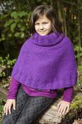 The portrait of a teenage girl wearing purple poncho Stock Photos
