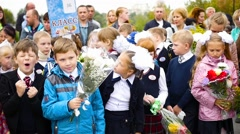 NOVOSIBIRSK, RUSSIA - September 2016: children on 1 September near the school Stock Footage
