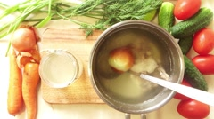 Man salt chicken broth in a saucepan Stock Footage