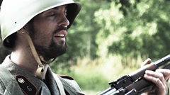 Soldier makes his rifle ready while other soldiers passing Stock Footage