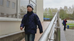 A small boy walking down a wheelchair ramp. Slow motion Stock Footage