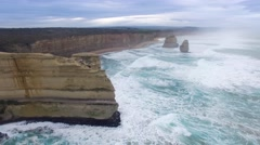 Round cinematic movement around 12 Apostles lookout revealing the main cluster Stock Footage