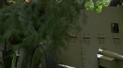 Soldiers move a Anti tank gun through a wild forest Stock Footage