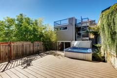Wooden walkout deck with hot tub. House exterior in Tacoma. Northwest, USA Stock Photos