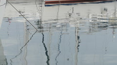 Slow Motion. White yachts in harbor, reflections in calm water, blue morning sky Stock Footage