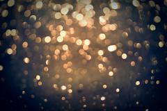 Golden glittering bokeh background Stock Photos
