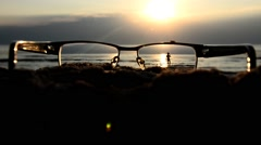 Optical glasses on the beach. To see well through the glasses. The concept of Stock Footage