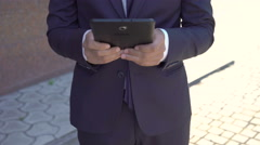 Businessman distracted from tablet on girl going out. 4K Stock Footage
