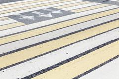 Marking a pedestrian crossing with stripes and arrows Stock Photos