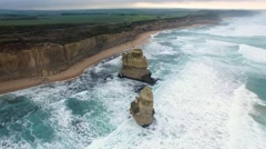 Drone flight over Gog and Magog rock formations towards the Great Ocean Road. Stock Footage