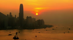 BOATS SUNSET BEHIND VICTORIA HARBOUR HONG KONG Stock Footage